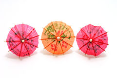 Three colored cocktail umbrella Royalty Free Stock Photo