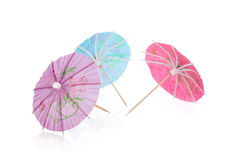 Three colored cocktail umbrellas Stock Photography