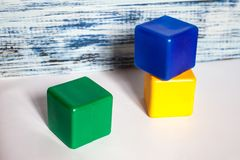 Three colored cubes stock images