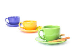 Three colored cups in a row Royalty Free Stock Photo
