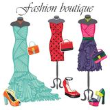 Three colored dresses with accessories.Fashion Stock Image