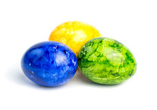 Three colored Easter eggs  on white background. Three colored (yellow, blue, green) Easter eggs  on white background Royalty Free Stock Images