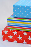 Three colored gifts on white background Royalty Free Stock Photography