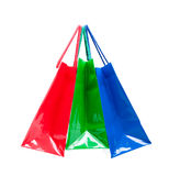 Three colored glossy gift bags suspended together Stock Photos