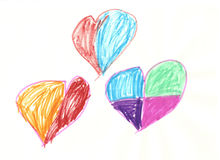 Three colored hearts. A child drawing of three colored hearts Royalty Free Stock Images
