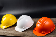 Three colored helmet for engineers Stock Images