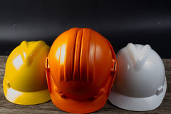 Three colored helmet for engineers Royalty Free Stock Photo