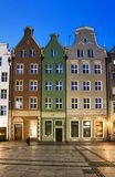 Three colored houses. On the square Royalty Free Stock Photo