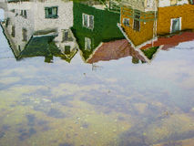 Three colored houses upside down Royalty Free Stock Images