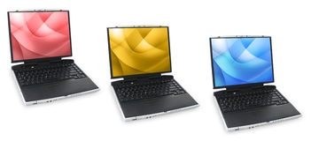 Three Colored Laptops. Three different laptops are against a white background. Each laptop has a red, yellow or blue screen graphic Royalty Free Stock Photo