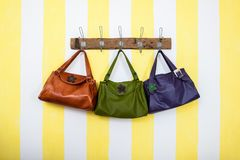 Three colored leather bags hanging royalty free stock images