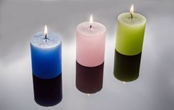 Colored candles in grey background royalty free stock images