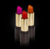 Three colored lipsticks Royalty Free Stock Photography