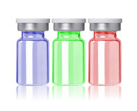 Three colored little glass bottle Royalty Free Stock Photos