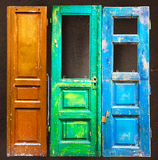 Three colored old wooden doors Stock Images
