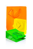 Three colored paper bags isolated Stock Image
