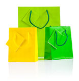 Three colored paper bags isolated on white Stock Photos