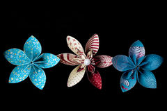 Three colored paper flowers Stock Photography