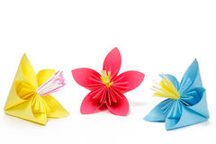 Three colored paper flowers Royalty Free Stock Image