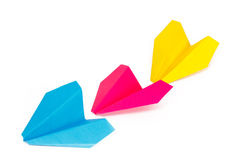 Three colored paper planes. On a white background Royalty Free Stock Photos