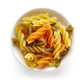 Three-colored pasta isolated on white, from above Royalty Free Stock Images