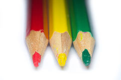 Three colored pencils Stock Images