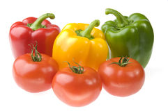 Three colored peppers and three tomatoes Royalty Free Stock Photos