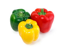 Three colored peppers vegetables isolated Royalty Free Stock Photo