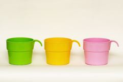 Three colored plastic cups Royalty Free Stock Photos