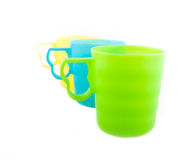 Three colored plastic cups. On the white Stock Photography