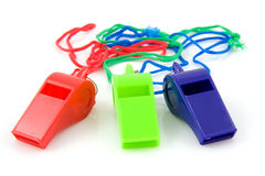 Three colored plastic whistles Stock Photo