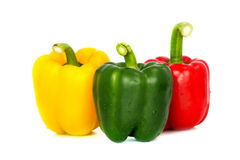 Three colored red Yellow green  Fresh bell pepper vegetarian ripe pepper paprika spices isolate Stock Photo