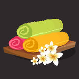 Three colored rolled folded fluffy terry towels isolated Stock Images
