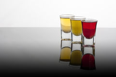Colored shot glasses Stock Image