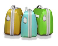 Three colored suitcases. Three bright colored suitcases on white isolated background with clipping path supplied Royalty Free Stock Photos