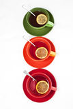 Three colored tea cups Stock Photo