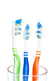 Three colored toothbrushes isolated on white Stock Image