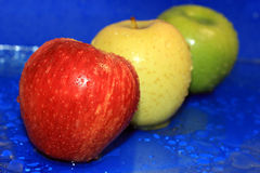Three colored wet apple Royalty Free Stock Photo