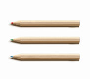 Three colored wooden pencils Royalty Free Stock Photos