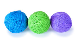 Three colored woolen balls. On a white background Stock Image