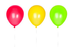 Three colorful balloons inflated. Isolated on white background Stock Photo