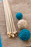 Three colorful balls and wooden needles Royalty Free Stock Photos