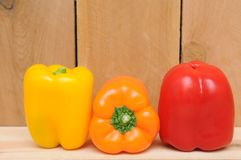 Three colorful bell peppers Stock Photos