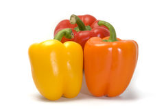 Three Colorful Bell Peppers. Three colored peppers stacked in a nice display, isolated on white Stock Photography
