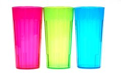 Three colorful beverage glasses. Isolated on white Royalty Free Stock Image
