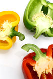 Three colorful capsicums Stock Images
