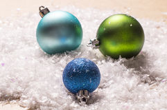 Three colorful christmas baubles Stock Photos