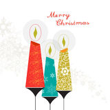 Three colorful Christmas candles with ornaments Stock Photos