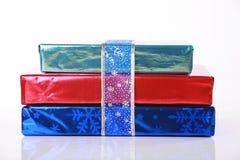 Three colorful Christmas presents. Three shiny colorful Christmas presents Stock Photography