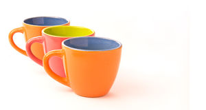 Three colorful coffee cups Stock Photography